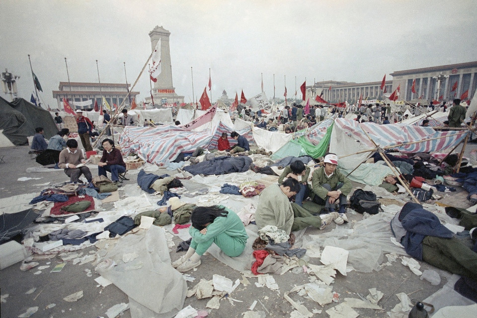 Students rest in the litter of Tiananmen Square in Beijing, as their strike for government reform enters its third week, May 28, 1989. (AP / Jeff Widener)