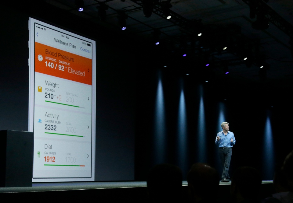 Apple senior vice president of Software Engineering Craig Federighi speaks about the Apple HealthKit app at the Apple Worldwide Developers Conference in San Francisco, Monday, June 2, 2014. (AP / Jeff Chiu)
