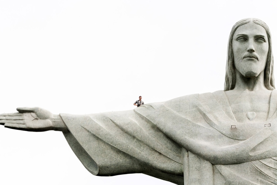 Lee Thompson is shown on the top of the Christ the Redeemer statue in Rio de Janeiro, Brazil. (Provided / The Flash Pack)