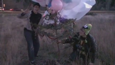 A Kelowna woman accidentally launched a Christmas tree into the air after tying it to a bunch of helium balloons. Nov. 27, 2011. (YouTube)