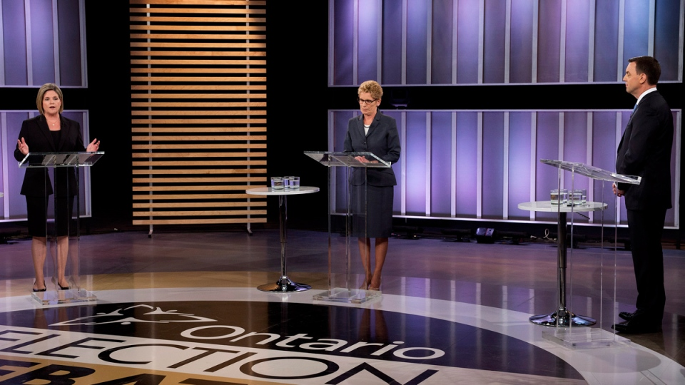 Ontario NDP leader Andrea Horwath, left, Ontario Liberal leader Kathleen Wynne, centre, and Ontario PC leader Tim Hudak, right, take part in the live leaders debate during the Ontario election in Toronto on Tuesday, June 3, 2014. (Frank Gunn / THE CANADIAN PRESS)