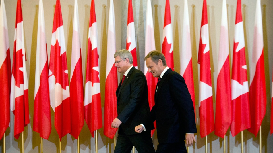 Prime Minister Stephen Harper meets with Polish Prime Minister Donald Tusk at the Chancellery of the Polish Prime Minister in Warsaw, Poland, Wednesday, June 4, 2014. (Adrian Wyld / THE CANADIAN PRESS)