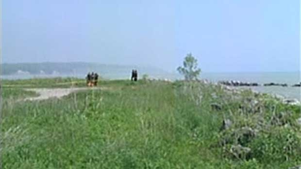 OPP work at the location where a body was found on the shores of Lake Erie in Port Stanley, Ont. on Tuesday, June 3, 2014. (Chuck Dickson / CTV London)