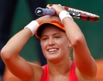 Canada's Eugenie Bouchard celebrates winning a quarter-final match at the French Open tennis tournament against Spain's Carla Suarez Navarro at the Roland Garros stadium in Paris, France Tuesday, June 3, 2014. Bouchard won in three sets 7-6, 2-6, 7-5. (AP Photo/Darko Vojinovic)