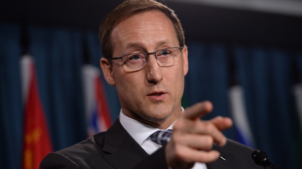 Justice Minister Peter MacKay takes questions a news conference on Parliament Hill in Ottawa on Wednesday, June 4, 2014. (Sean Kilpatrick / THE CANADIAN PRESS)