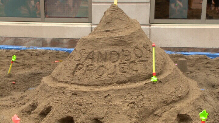 A giant sandbox took up half a block on Sparks St. in Ottawa's downtown core on Wednesday, June 4, 2014.