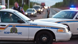 In this file photo, RCMP vehicles are seen in Moncton, N.B.on Wednesday June 4, 2014. (Marc Grandmaison / THE CANADIAN PRESS)
