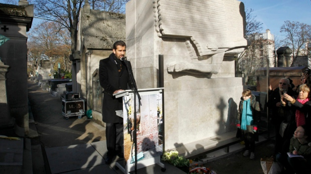 British actor Rupert Everett delivers a speech as he attends the unveiling of Oscar Wilde's newly renovated tombstone which coincides with the 111th anniversary of his death, at the Pere Lachaise cemetery, in Paris, Wednesday, Nov. 30, 2011.