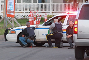 Lockdown continues as suspect remains at large