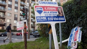 For sale signs in front of a Montreal, Quebec, condominium on September 27, 2011. (THE CANADIAN PRESS / Ryan Remiorz)