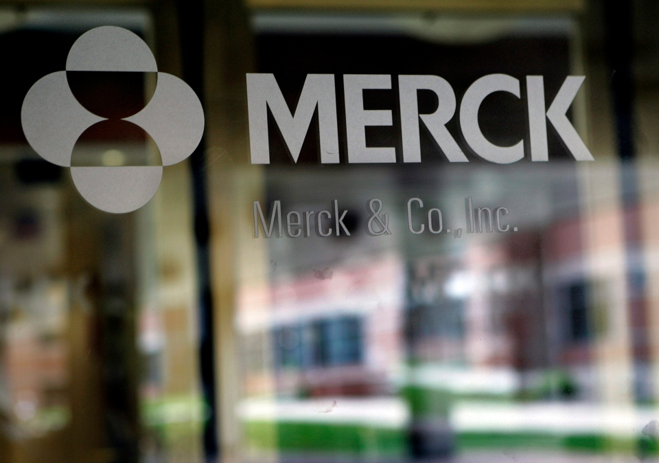 In this May 22, 2008 file photo, the company logo is seen on the doors of a building at Merck & Co. Inc. headquarters in Whitehouse Station, N.J. (AP Photo/Mel Evans, file)
