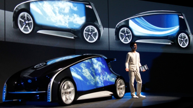 A presenter explains about Toyota Fun-Vii in Tokyo Monday, Nov. 28, 2011. Toyota Motor Corp. unveiled the futuristic concept car resembling a giant smartphone to demonstrate how Japan's top automaker is trying to take the lead in technology at the upcoming Tokyo auto show, which opens to the public this weekend. (AP / Koji Sasahara)