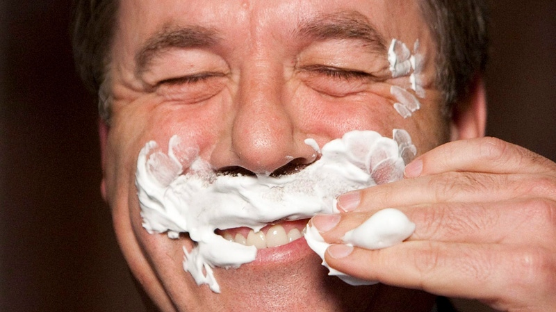 "NDP MP Peter Stoffer (Sackville-Eastern Shore) laughs as he has his moustache shaved off by MP Glenn Thibeault as part of a campaign to raise funds and awareness for prostate cancer research, known as ""Movember"" in the foyer of the House of Commons on Parliament Hill in Ottawa on Monday Nov. 1, 2010."