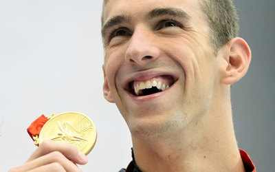 Michael Phelps of the United States with his gold medal in the men's 200-metre individual medley during the swimming competitions in the National Aquatics Centre at the Beijing 2008 Olympics in Beijing, Friday, Aug. 15, 2008. (AP / Itsuo Inouye)