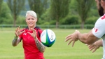 Rugby Canada team member Jen Kish wears her new uniform at the team's practice facility in Burnaby, B.C. Tuesday, June, 3, 2014. (Jonathan Hayward / THE CANADIAN PRESS)