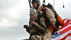 93-year-old U.S. WWII veteran Jim Martin of the 101st Airborne, left, completes a tandem parachute jump onto Utah Beach, western France, Thursday, June 5, 2014. (AP / Thibault Camus)