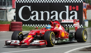 Ferrari driver Fernando Alonso from Spain drives into the pits during the first practice session at the Canadian Grand Prix, in Montreal, Friday, June 6, 2014. (Paul Chiasson / THE CANADIAN PRESS)