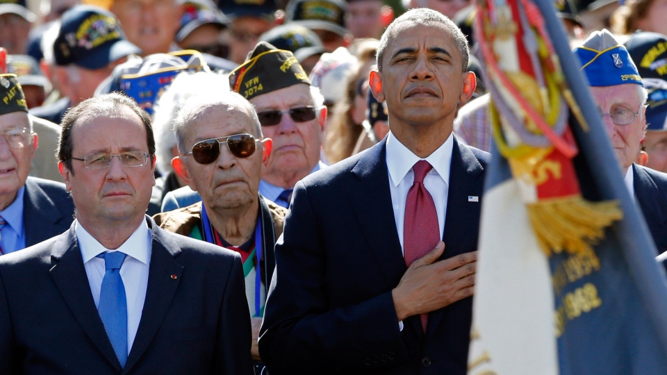 U.S. President Barack Obama, center, and French President Francois Hollande left front, participate in the 70th French-American commemoration D-Day ceremony at the Normandy American Cemetery and Memorial in Colleville-sur-Mer, France on Friday, June 6, 2014. (AP / Pascal Rossignol)