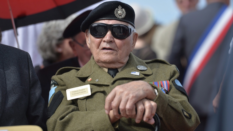 Canadian veteran Francis Godon waits for the start of a ceremony at Juno Beach in Courseulles-sur-Mer, France, Friday June 6, 2014. (Adrian Wyld / THE CANADIAN PRESS)
