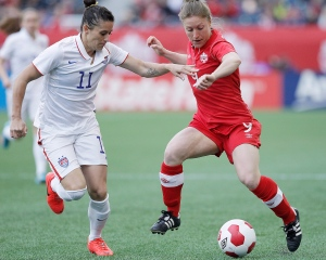 USA's defender Ali Krieger (11) defends against Canada's forward Josée Bélanger (9) during first half soccer action of a friendly match in Winnipeg, Thursday, May 8, 2014. (/John Woods / THE CANADIAN PRESS)