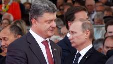 Putin walks past Poroshenko at D-Day ceremony