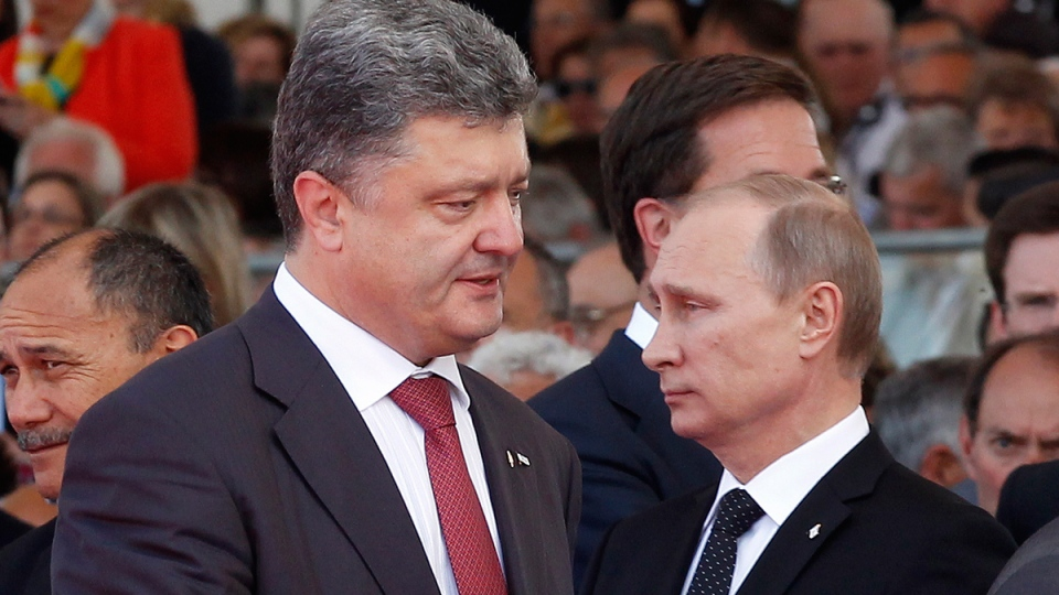 Ukraine's President-elect Petro Poroshenko, left, walks past Russian President Vladimir Putin during the commemoration of the 70th anniversary of the D-Day in Ouistreham, western France, Friday, June 6, 2014. (AP / Christophe Ena)