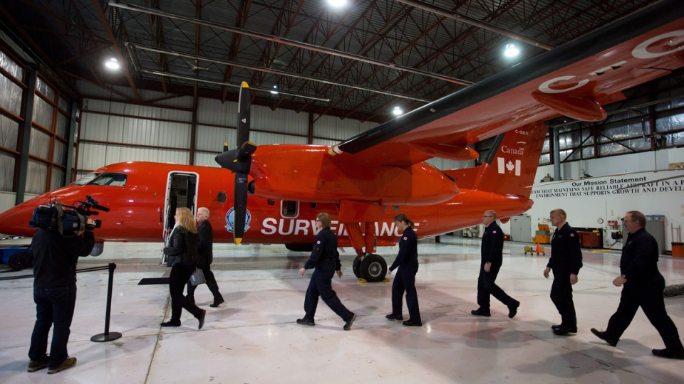 Minister of Transport Lisa Raitt, second left, inspects a Dash-8 surveillance aircraft in Richmond, B.C., in this file photo from Wednesday, February 19, 2014. (THE CANADIAN PRESS/Darryl Dyck)