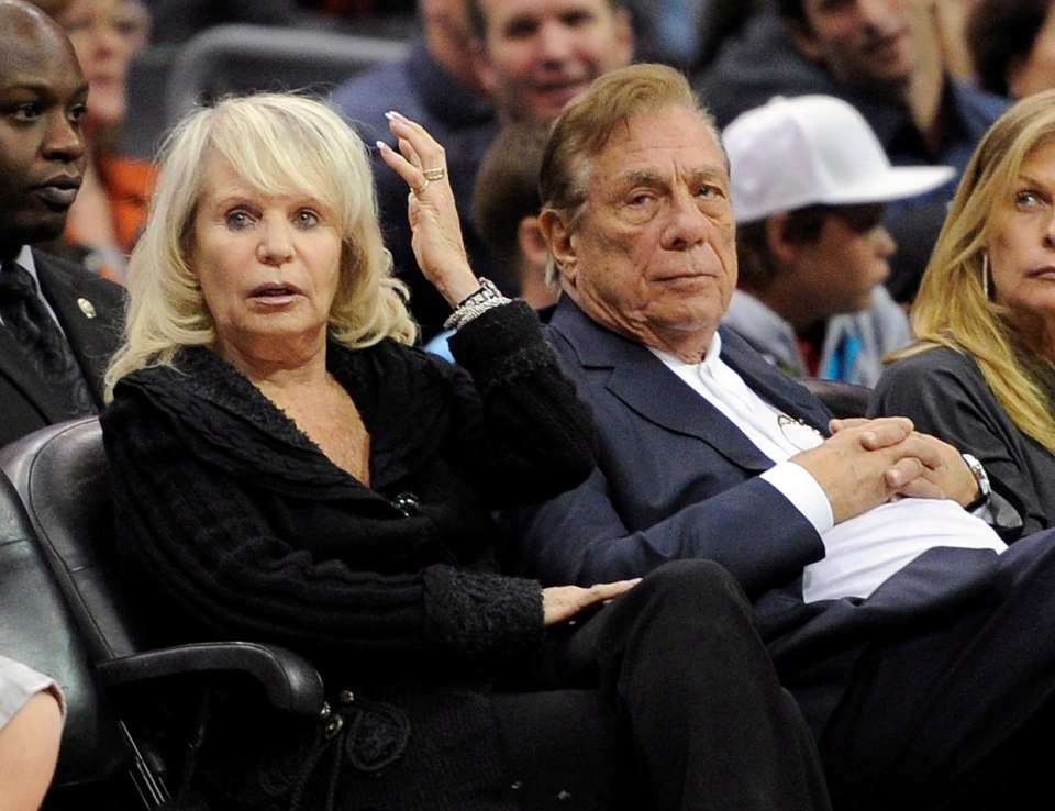 Shelly Sterling sits with her husband, Donald Sterling, right, during the Los Angeles Clippers' NBA basketball game against the Detroit Pistons in Los Angeles in this Nov. 12, 2010, file photo. (AP Photo/Mark J. Terrill, File)