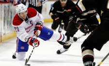 Brian Gionta fires off a pass in the first period of an NHL hockey game against the Anaheim Ducks (Nov. 30, 2011)