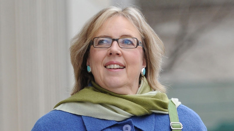 Green Party Leader Elizabeth May leaves a press conference in Ottawa on Dec. 1, 2011