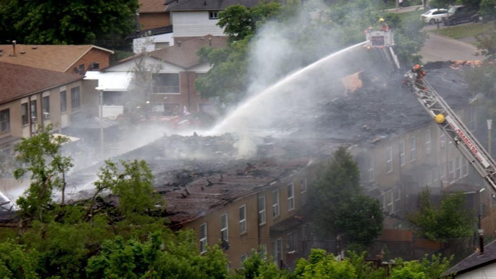 Firefighters extinguish a townhouse fire in Brampt