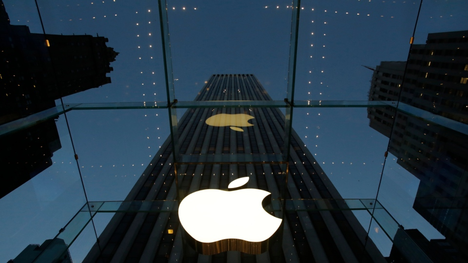 The Apple logo is illuminated in the entrance to the Fifth Avenue Apple store, in New York, Wednesday, Nov. 20, 2013. (AP Mark Lennihan)
