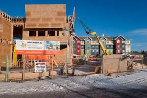 Construction crews build housing and community centres in Saskatoon, Sask., on Feb. 2, 2012. THE CANADIAN PRESS/Liam Richards