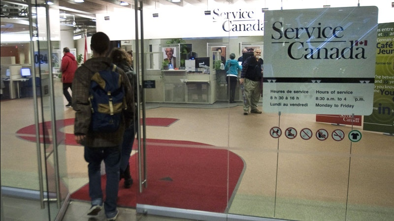 People enter a Service Canada office Friday, Dec. 2, 2011 in Montreal.  (Ryan Remiorz / THE CANADIAN PRESS)