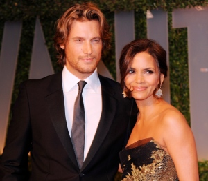 In this Feb. 22, 2009 file photo, actress Halle Berry, right, and Gabriel Aubry arrive at the Vanity Fair Oscar party in West Hollywood, Calif. A judge approved a partial child support settlement on Friday, May 30, 2014, that requires Berry to pay her ex-boyfriend $16,000 a month, or nearly $200,000 a year, to support their 6-year-old daughter.  (AP / Evan Agostini, file)