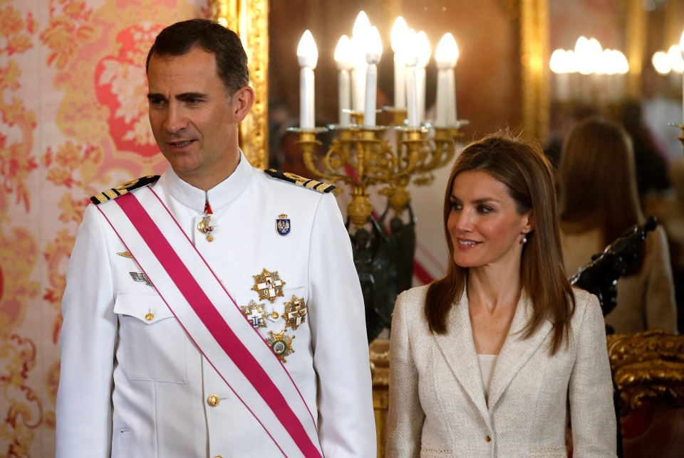 Spanish Crown Prince Felipe with Princess Letizia, attend a reception marking Spain's Armed Forces Day at the Royal palace in Madrid, Spain, Sunday, June 8, 2014. (AP Photo/Andrea Comas, Pool)