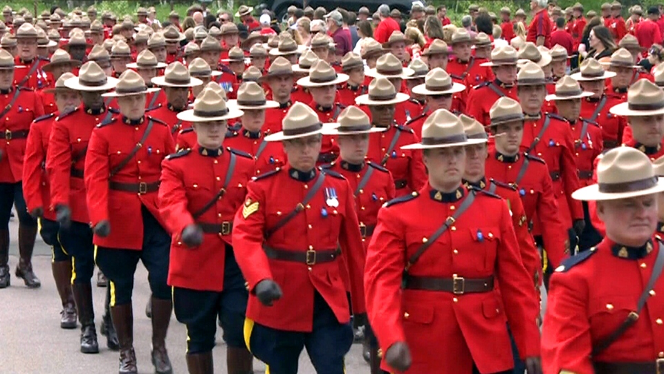 Funeral procession for the three fallen RCMP officers underway in Moncton, N.B., Tuesday, June 10, 2014.