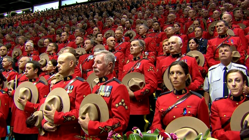 RCMP officers, dignitaries and members of the public participate in the regimental funeral in Moncton, N.B., Tuesday, June 10, 2014.