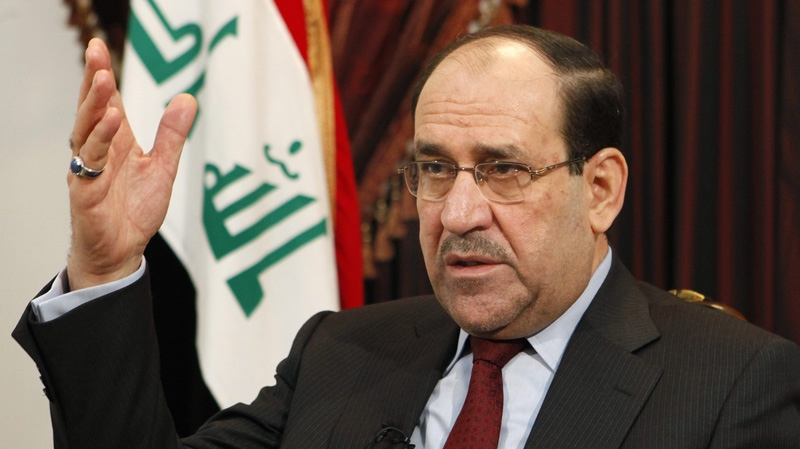 Iraq's Prime Minister Nouri al-Maliki speaks during an interview with The Associated Press in Baghdad, Iraq, Saturday, Dec. 3, 2011. (AP / Hadi Mizban)