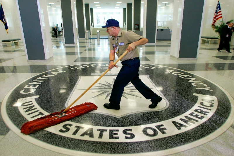 In this 2005 file photo, a workman slides a dustmop over the floor at the Central Intelligence Agency headquarters in Langley, Va., near Washington. (AP / J. Scott Applewhite)