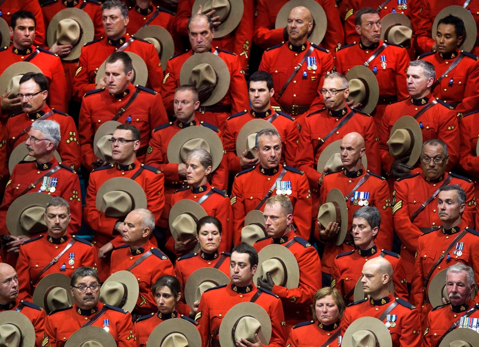 RCMP officers attend the regimental funeral of three slain officers at the Moncton Coliseum in Moncton, N.B. on Tuesday, June 10, 2014. (Andrew Vaughan / THE CANADIAN PRESS)