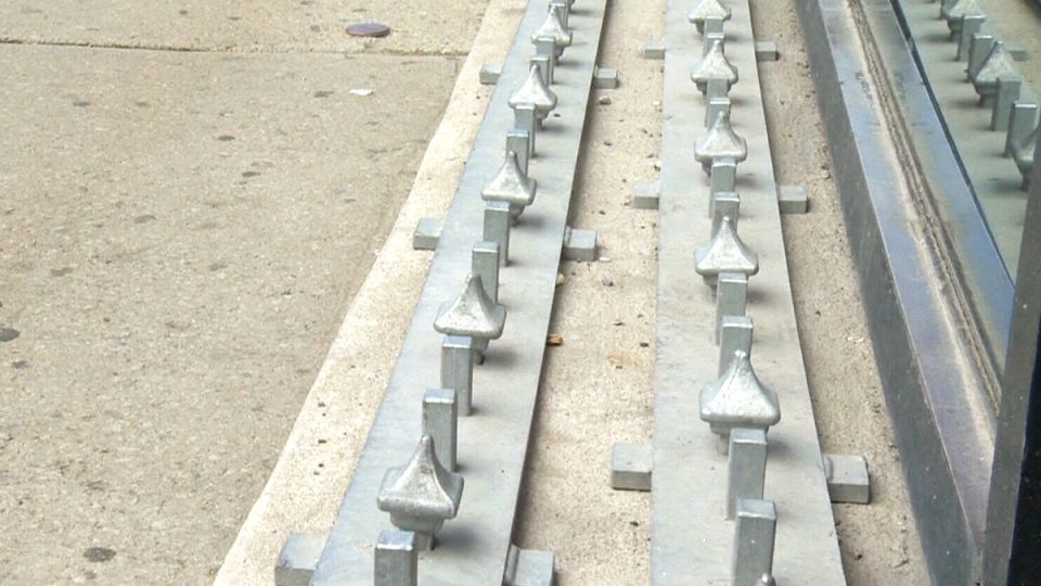 Two grey strips lined with dull spikes were removed from the ledge outside a Montreal music store on Tuesday.