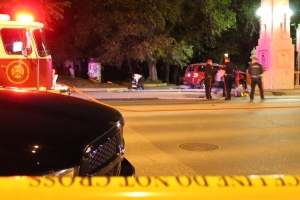 Emergency responders attend to a fatal collision between a motorcycle and an SUV near the Albert Street bridge on Tuesday night.
