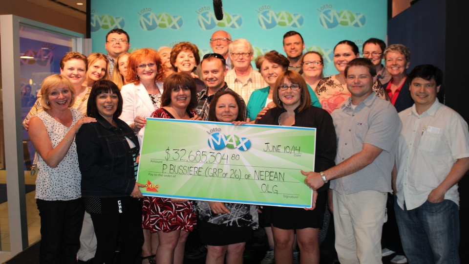 CRA employees collecting their $32-million cheque. (OLG)