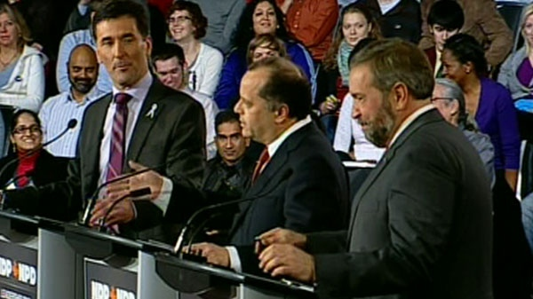 From the left: Paul Dewar, Brian Topp, and Thomas Mulcair participate in the NDP leadership debate in Ottawa on Sunday, Dec. 4, 2011.