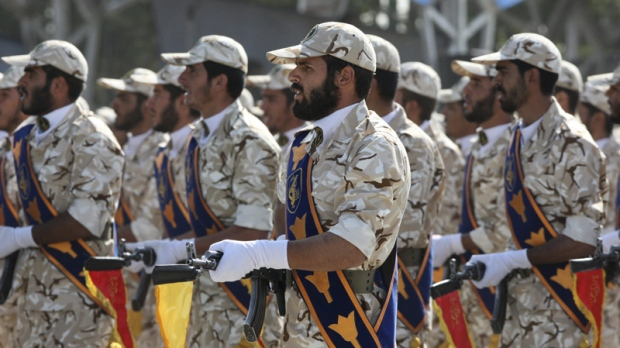 In this Sept. 22, 2011 photo, members of Iran's Revolutionary Guard march in front of the mausoleum of the late Iranian revolutionary founder Ayatollah Khomeini, just outside Tehran, Iran, during armed an forces parade marking the 31st anniversary of the start of the Iraq-Iran war. (Vahid Salemi/AP Photo)