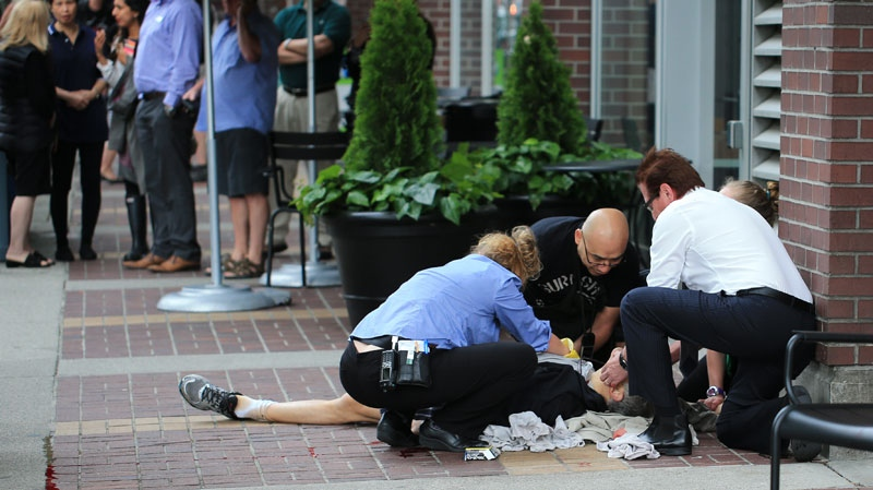Paul Dragan, 52, is treated after being shot outside a Starbucks in downtown Vancouver on June 10, 2014. (Nigel Horsley)
