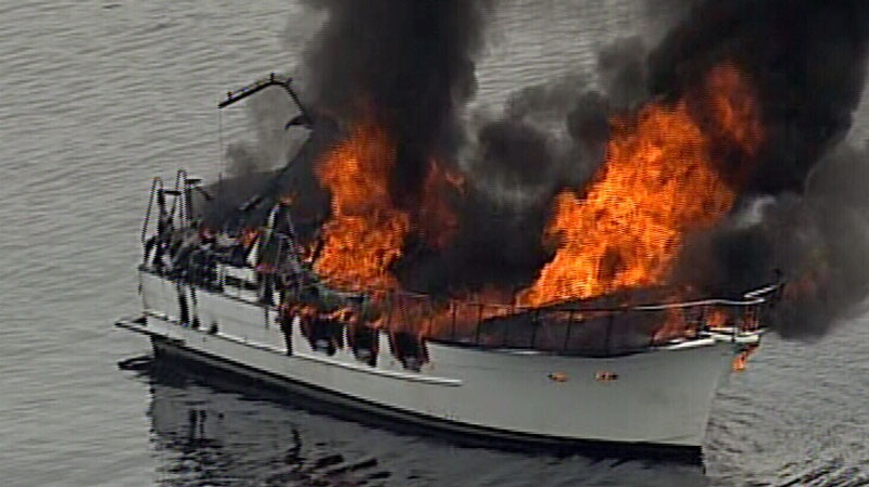The fishing boat remained engulfed in flames around 4:30 p.m. Wednesday, June 11, 2014. (CTV/Chopper 9)