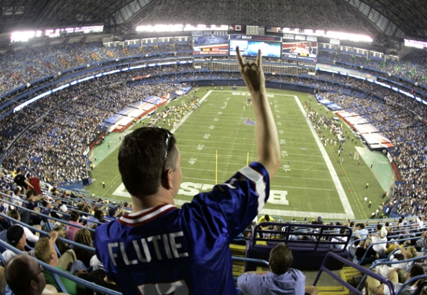 Buffalo Bills fan Dan Malette, of North Bay, Ont., tries to get the attention of a friend during the second half of a pre-season NFL football game between the Bills and the Pittsburgh Steelers at the Rogers Centre in Toronto, Thursday, Aug. 14, 2008. (AP / David Duprey)