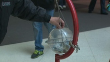 Plunking a donation into a Salvation Army kettle